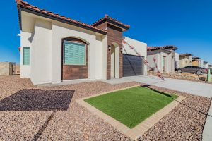 A brand new luxury Santana home is displayed from the front left side in El Paso