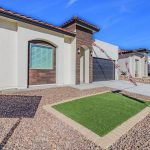 A brand new luxury Santana home is displayed from the front-left corner in El Paso